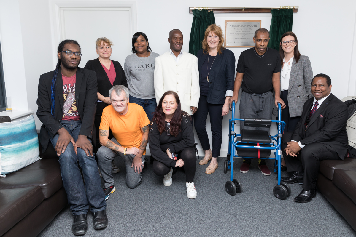 Some of the residents and staff of Henderson House with Sarah Jones MP